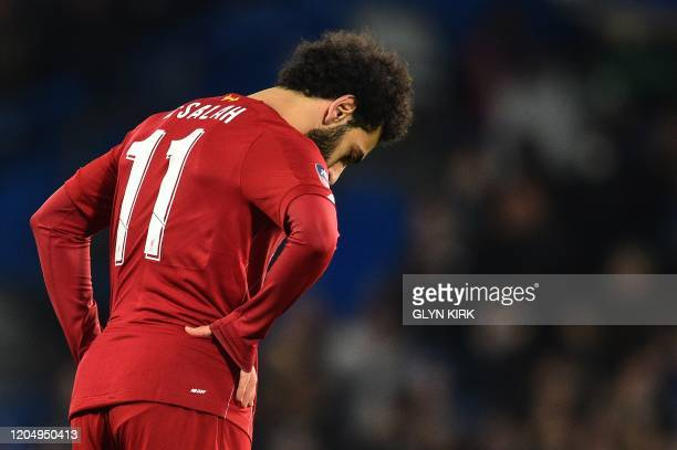 Liverpool's Egyptian midfielder Mohamed Salah reacts during the English FA Cup fifth round football match between Chelsea and Liverpool at Stamford...