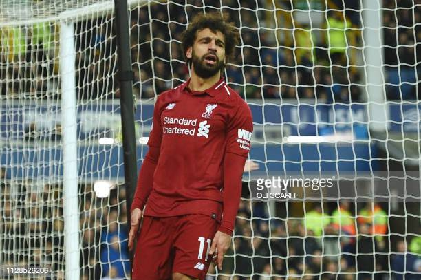 Liverpool's Egyptian midfielder Mohamed Salah reacts during the English Premier League football match between Everton and Liverpool at Goodison Park...