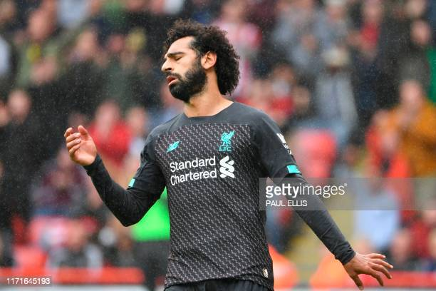 Liverpool's Egyptian midfielder Mohamed Salah reacts during the English Premier League football match between Sheffield United and Liverpool at...