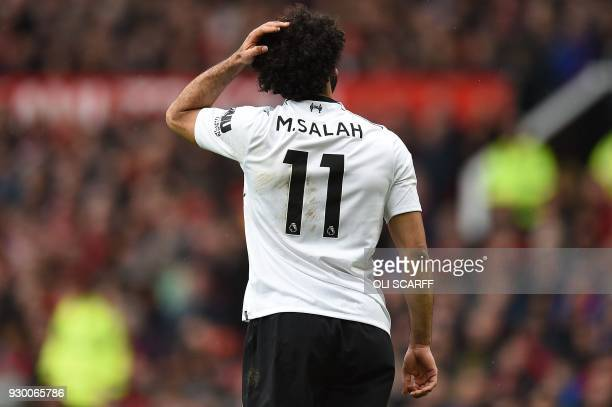 Liverpool's Egyptian midfielder Mohamed Salah reacts during the English Premier League football match between Manchester United and Liverpool at Old...