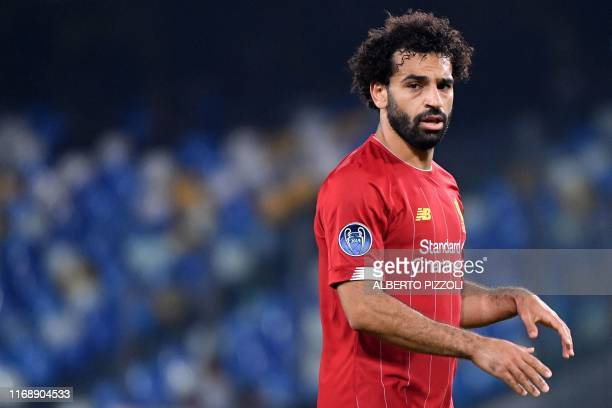Liverpool's Egyptian midfielder Mohamed Salah reacts during the UEFA Champions League Group E football match Napoli vs Liverpool on September 17 2019...