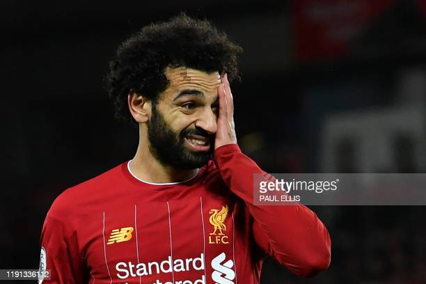 Liverpool's Egyptian midfielder Mohamed Salah reacts to a missed chance during the English Premier League football match between Liverpool and...