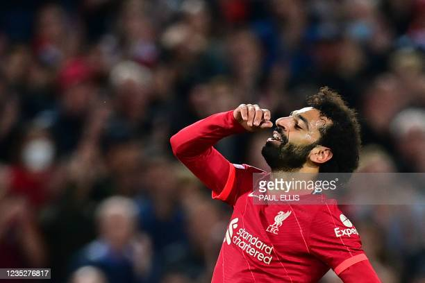 Liverpool's Egyptian midfielder Mohamed Salah reacts to a missed penalty during the UEFA Champions League 1st round Group B football match between...