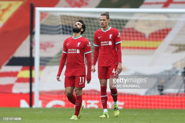 Liverpool's Egyptian midfielder Mohamed Salah reacts to going behind during the English Premier League football match between Liverpool and Fulham at...