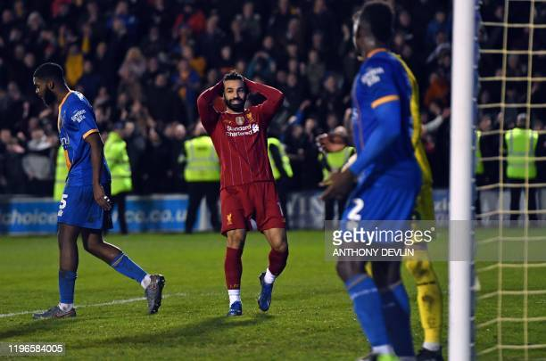 Liverpool's Egyptian midfielder Mohamed Salah reacts to missing a header late in the game during the English FA Cup fourth round football match...