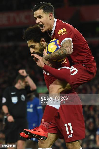 Liverpool's Egyptian midfielder Mohamed Salah reacts with Liverpool's Brazilian midfielder Philippe Coutinho after scoring the opening goal of the...