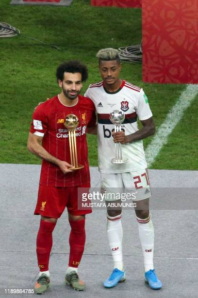 Liverpool's Egyptian midfielder Mohamed Salah receives the Golden Ball award and Flamengo's forward Bruno Henrique receives the Silver Ball award...