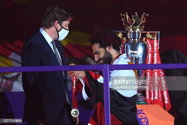 Liverpool's Egyptian midfielder Mohamed Salah recieves his Premier League winner medals during the presentation following the English Premier League...
