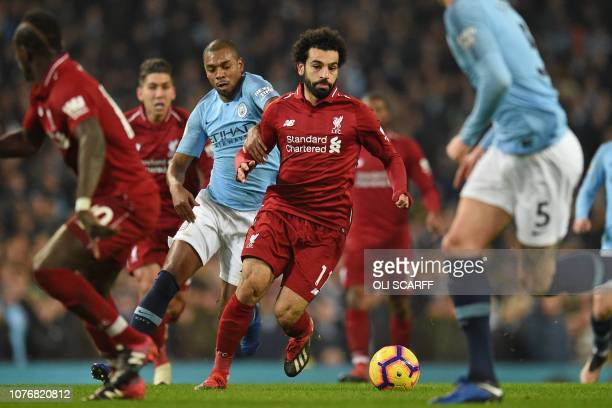 Liverpool's Egyptian midfielder Mohamed Salah runs with the ball during the English Premier League football match between Manchester City and...
