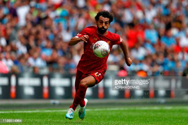 TOPSHOT Liverpool's Egyptian midfielder Mohamed Salah runs with the ball during the English FA Community Shield football match between Manchester...