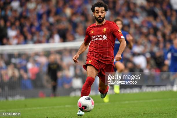 Liverpool's Egyptian midfielder Mohamed Salah runs with the ball during the English Premier League football match between Chelsea and Liverpool at...