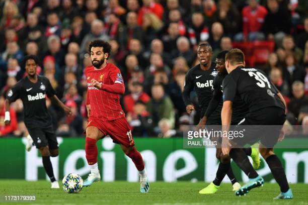 Liverpool's Egyptian midfielder Mohamed Salah runs with the ball during the UEFA Champions league Group E football match between Liverpool and...