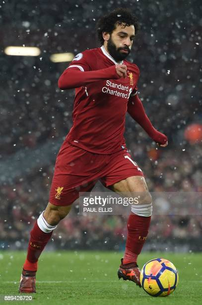 Liverpool's Egyptian midfielder Mohamed Salah runs with the ball during the English Premier League football match between Liverpool and Everton at...