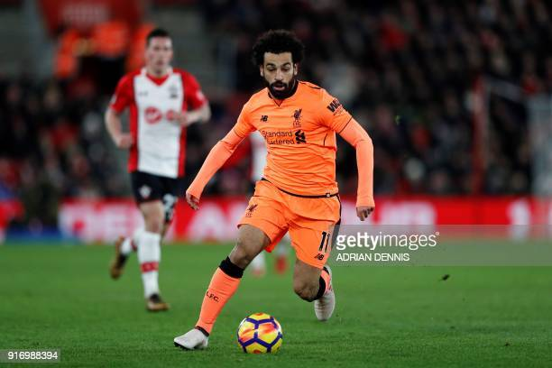 Liverpool's Egyptian midfielder Mohamed Salah runs with the ball during the English Premier League football match between Southampton and Liverpool...