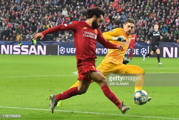 TOPSHOT Liverpool's Egyptian midfielder Mohamed Salah scores during the UEFA Champions League Group E football match between RB Salzburg and...