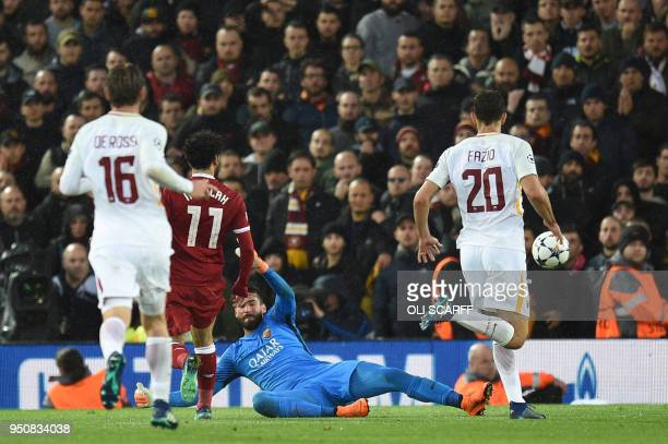 Liverpool's Egyptian midfielder Mohamed Salah scores his second goal past Roma's Brazilian goalkeeper Alisson during the UEFA Champions League first...