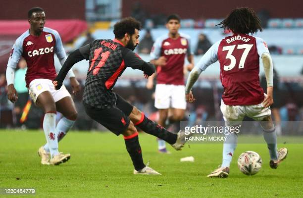 Liverpool's Egyptian midfielder Mohamed Salah scores his team's fourth goal during the English FA Cup third round football match between Aston Villa...