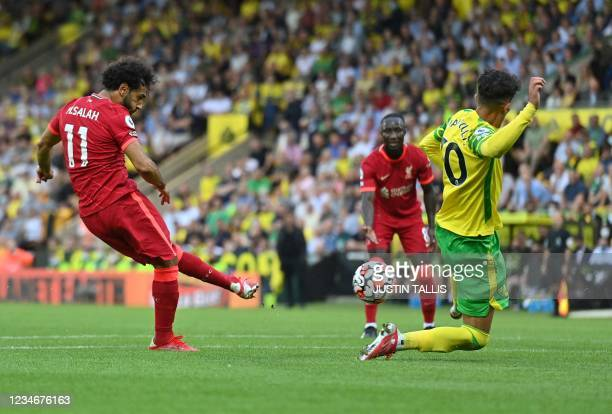 Liverpool's Egyptian midfielder Mohamed Salah scores his team's third goal during the English Premier League football match between Norwich City and...