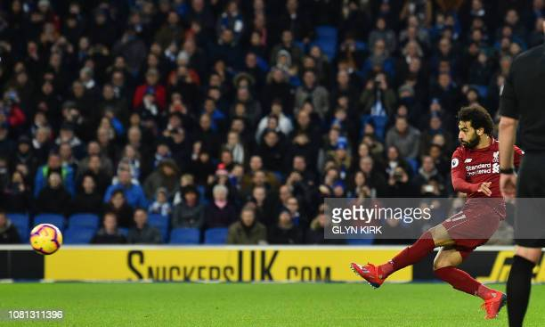 Liverpool's Egyptian midfielder Mohamed Salah scores the opening goal from the penalty spot during the English Premier League football match between...