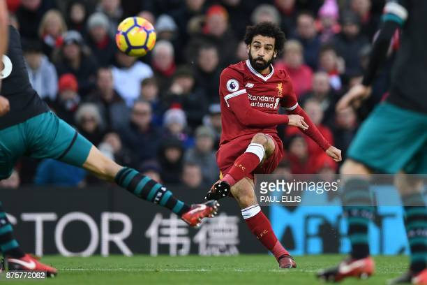 Liverpool's Egyptian midfielder Mohamed Salah scores the opening goal during the English Premier League football match between Liverpool and...