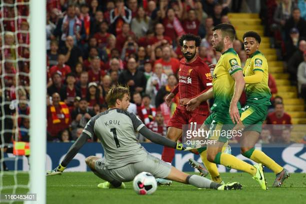 Liverpool's Egyptian midfielder Mohamed Salah scores the team's second goal during the English Premier League football match between Liverpool and...