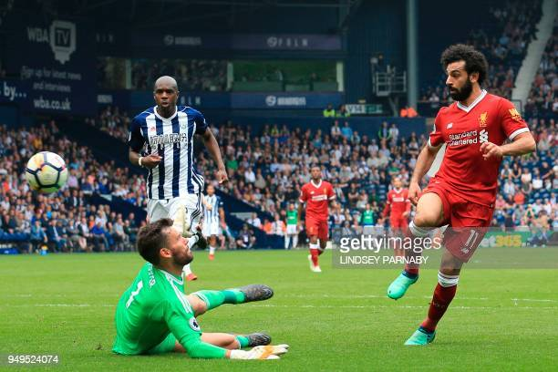 Liverpool's Egyptian midfielder Mohamed Salah scores their second goal during the English Premier League football match between West Bromwich Albion...
