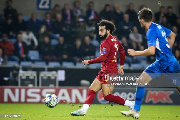 Liverpool's Egyptian midfielder Mohamed Salah shoots and scores a goal during the UEFA Champions League Group E football match between Genk and...
