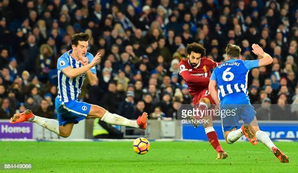 Liverpool's Egyptian midfielder Mohamed Salah shoots but doesn't score during the English Premier League football match between Brighton and Hove...