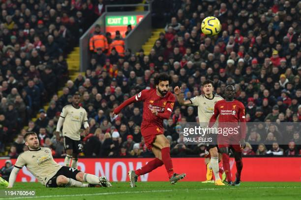 Liverpool's Egyptian midfielder Mohamed Salah shoots but misses the target during the English Premier League football match between Liverpool and...