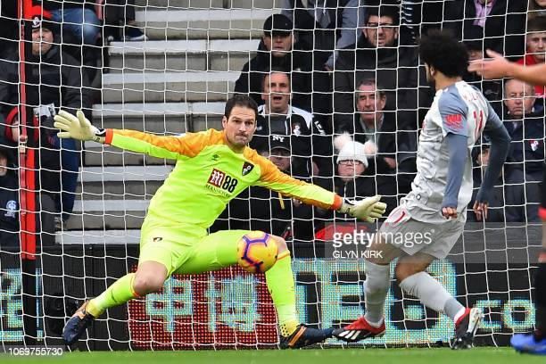 Liverpool's Egyptian midfielder Mohamed Salah shoots past Bournemouth's Bosnian-Herzegovinian goalkeeper Asmir Begovic to score the opening goal of...