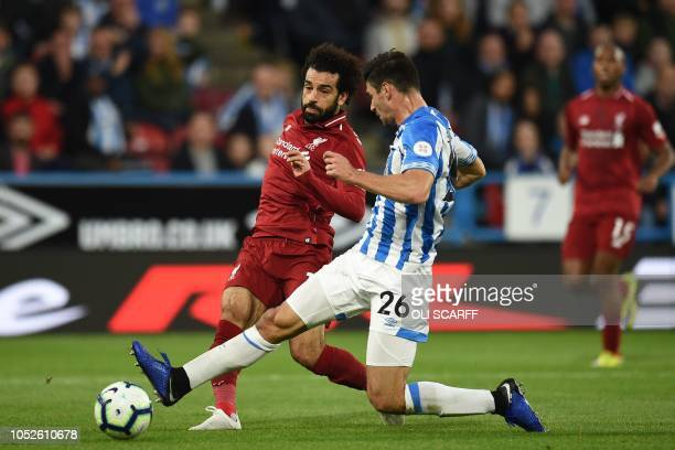 Liverpool's Egyptian midfielder Mohamed Salah shoots past Huddersfield Town's German defender Christopher Schindler to score the opening goal of the...