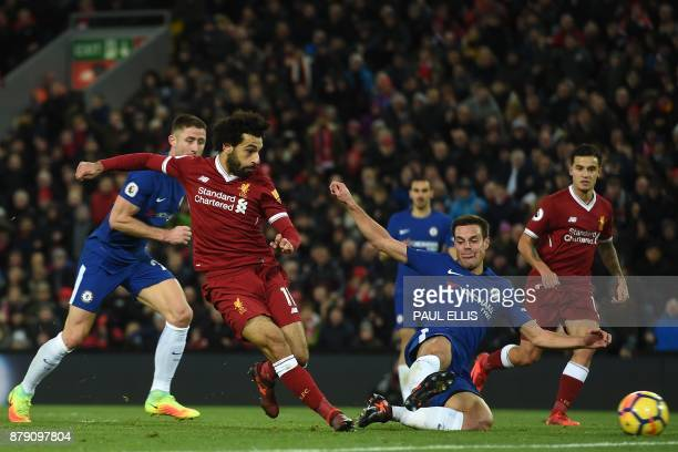 Liverpool's Egyptian midfielder Mohamed Salah shoots past the challenge of Chelsea's Spanish defender Cesar Azpilicueta to score the opening goal of...