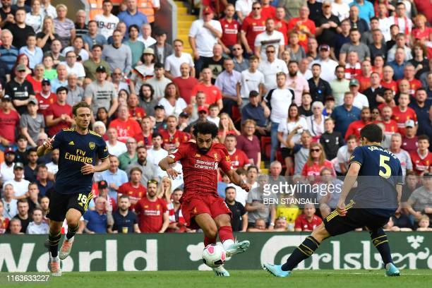 Liverpool's Egyptian midfielder Mohamed Salah shoots to score his second goal Liverpool's third during the English Premier League football match...