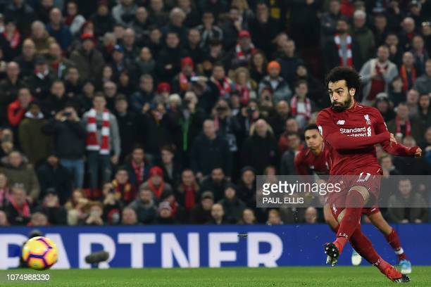 Liverpool's Egyptian midfielder Mohamed Salah shoots to score their second goal from the penalty spot during the English Premier League football...