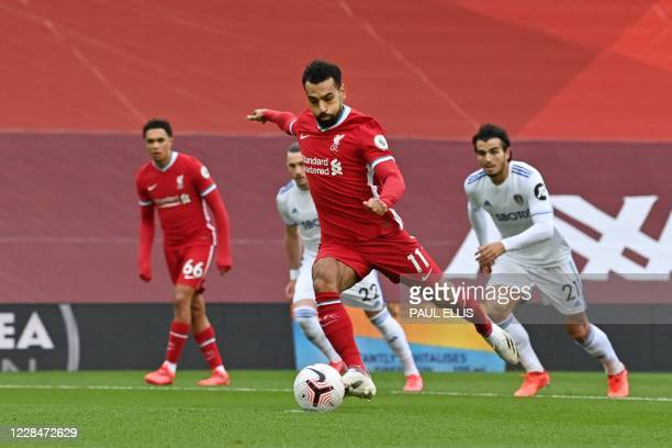 Liverpool's Egyptian midfielder Mohamed Salah takes a penalty to score the opening goal during the English Premier League football match between...