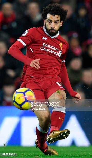 Liverpool's Egyptian midfielder Mohamed Salah takes a shot but doesn't score during the English Premier League football match between Liverpool and...