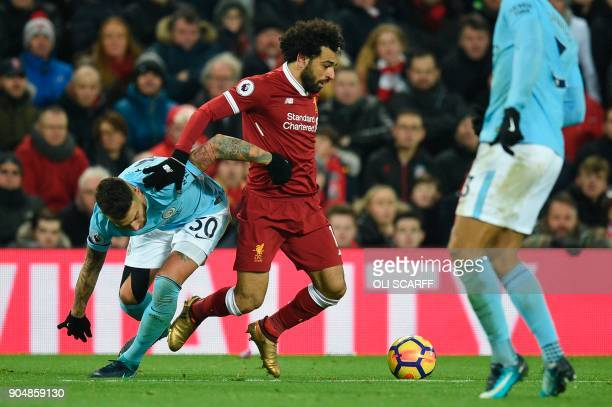 Liverpool's Egyptian midfielder Mohamed Salah tangles with Manchester City's Argentinian defender Nicolas Otamendi during the English Premier League...