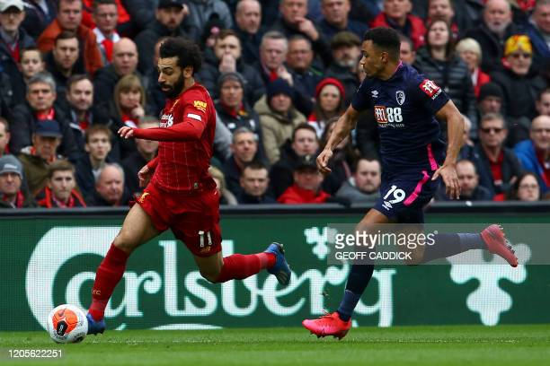 Liverpool's Egyptian midfielder Mohamed Salah vies with Bournemouth's English midfielder Junior Stanislas during the English Premier League football...