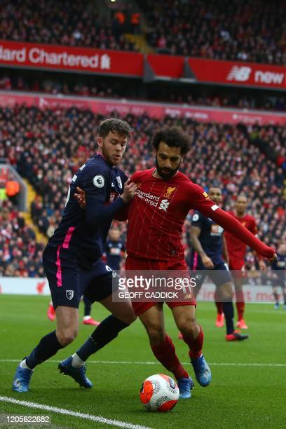 Liverpool's Egyptian midfielder Mohamed Salah vies with Bournemouth's English defender Jack Simpson during the English Premier League football match...