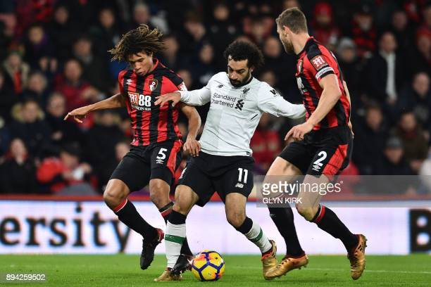 Liverpool's Egyptian midfielder Mohamed Salah vies with Bournemouth's Dutch defender Nathan Ake and Bournemouth's English defender Simon Francis...