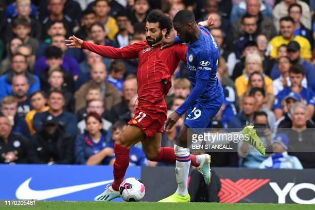 Liverpool's Egyptian midfielder Mohamed Salah vies with Chelsea's Canadianborn English defender Fikayo Tomori during the English Premier League...