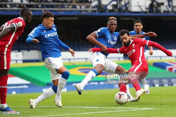 Liverpool's Egyptian midfielder Mohamed Salah vies with Everton's Colombian defender Yerry Mina during the English Premier League football match...