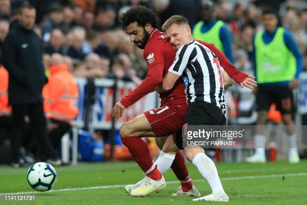 Liverpool's Egyptian midfielder Mohamed Salah vies with Newcastle United's Scottish midfielder Matt Ritchie during the English Premier League...