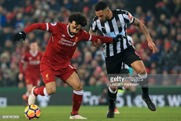 Liverpool's Egyptian midfielder Mohamed Salah vies with Newcastle United's English defender Jamaal Lascelles during the English Premier League...