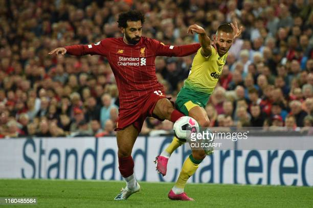 TOPSHOT Liverpool's Egyptian midfielder Mohamed Salah vies with Norwich City's German midfielder Moritz Leitner during the English Premier League...