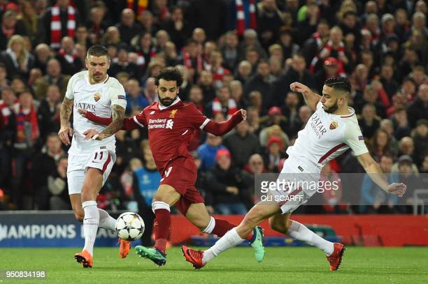 TOPSHOT Liverpool's Egyptian midfielder Mohamed Salah vies with Roma's Croatian defender Aleksandar Kolarov and Roma's Czech striker Patrik Schick...