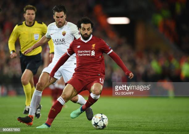 TOPSHOT Liverpool's Egyptian midfielder Mohamed Salah vies with Roma's Dutch midfielder Kevin Strootman during the UEFA Champions League first leg...