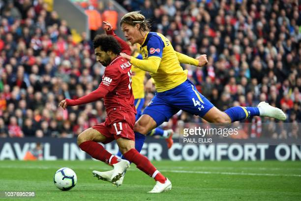 Liverpool's Egyptian midfielder Mohamed Salah vies with Southampton's Danish defender Jannik Vestergaard during the English Premier League football...