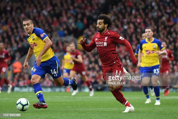 Liverpool's Egyptian midfielder Mohamed Salah vies with Southampton's Spanish midfielder Oriol Romeu during the English Premier League football match...