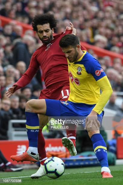 Liverpool's Egyptian midfielder Mohamed Salah vies with Southampton's Dutch defender Wesley Hoedt during the English Premier League football match...
